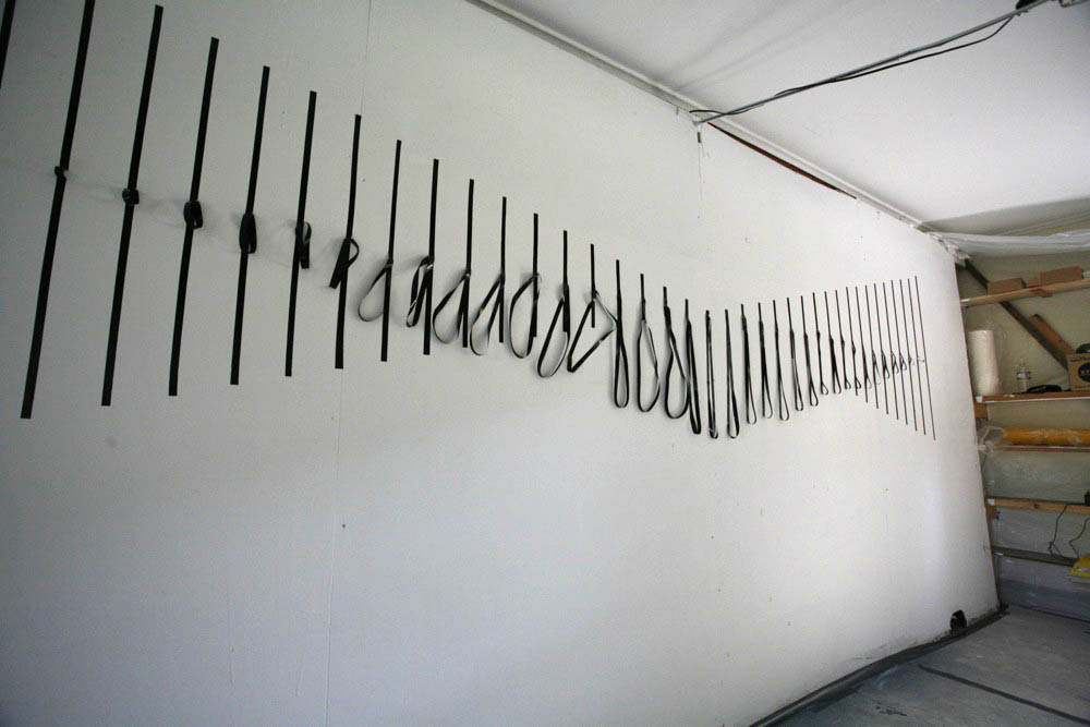 "Cut vinyl on wall. 36"" x 444"", 2008."